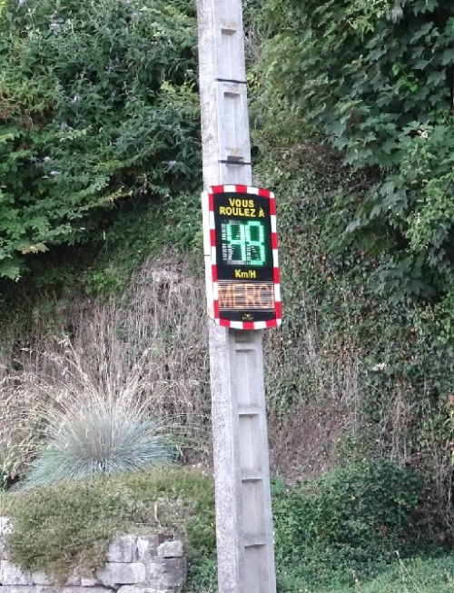 """Caudebec speed sign - note if you are within the speed limit - it says """"Merci""""!"""