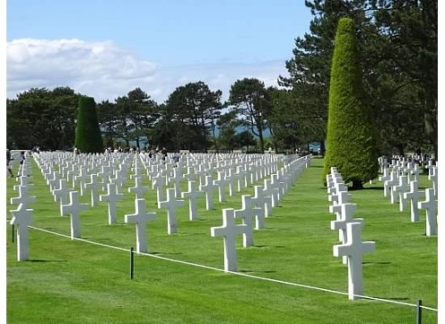 A virtual sea of crosses and stars of David in the U.S. cemetary; more powerful than you could expect