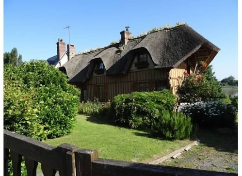 Thatched roof home in the Normandy region