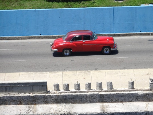 first vintage car with zoom lens taken from ship